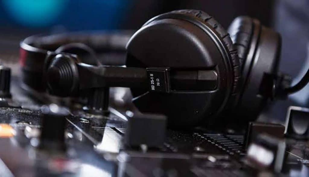 Dj headphones sitting on a Dj controller