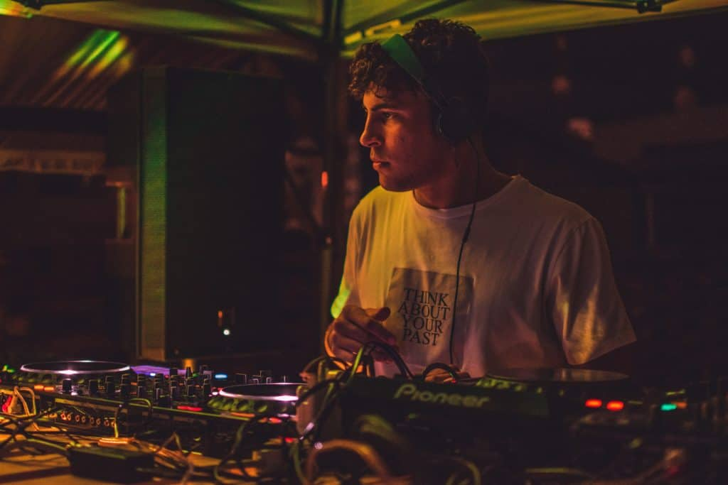 A DJ listens and analyzes his own work