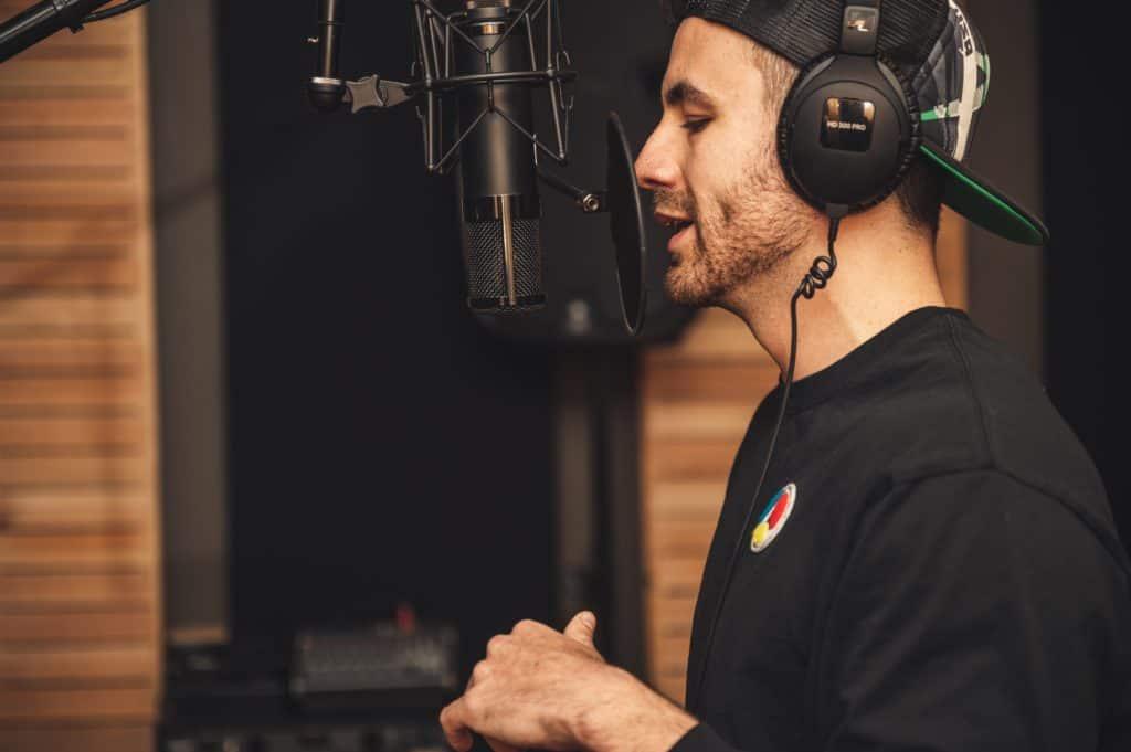 A DJ recording his own vocal loop