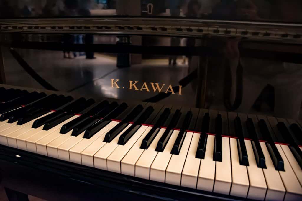 A close up photography of a Kawai piano keys