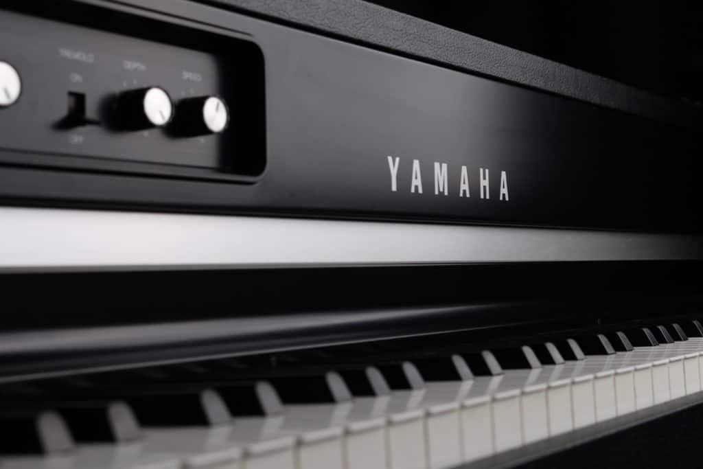 A close up photography of a Yamaha grand piano