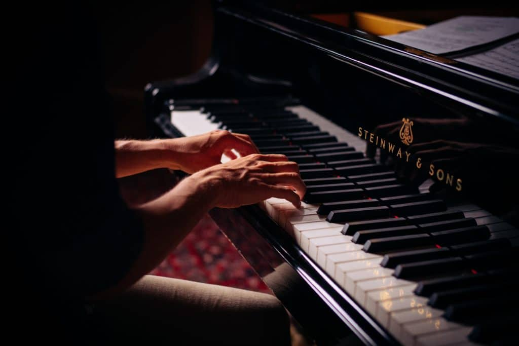 A man playing a Steinway & Sons piano