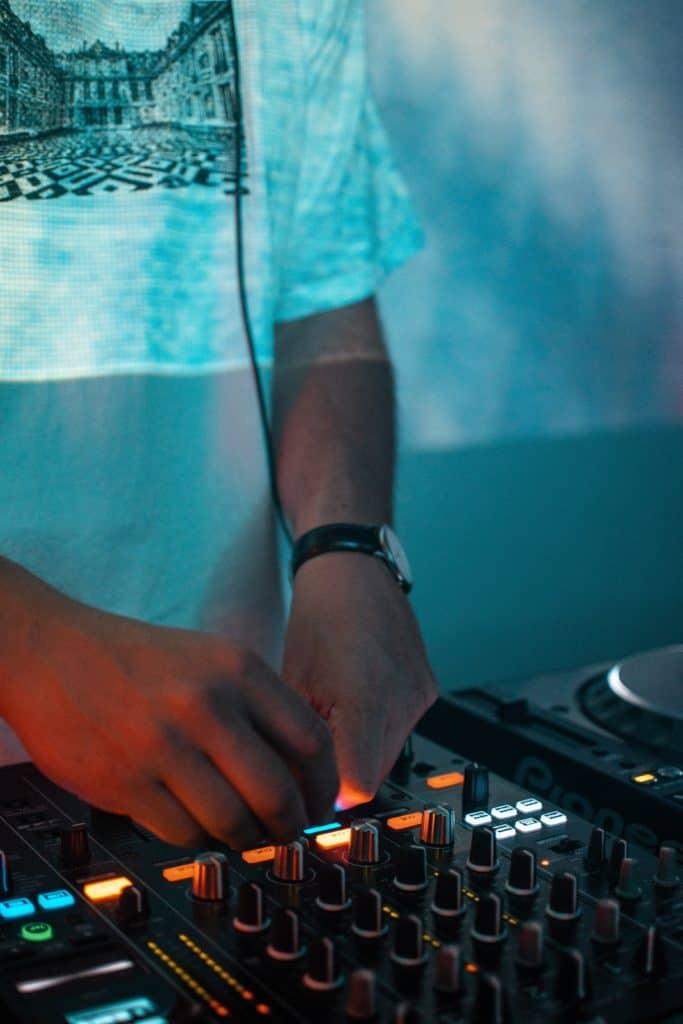 A man using a DJ mixer