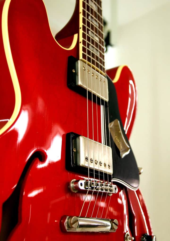 A red semi-hollow body guitar